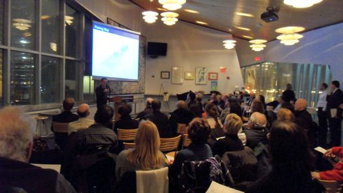 Tom Powers of the Harbor Islands Alliance presents at the Aquarium Cafe.