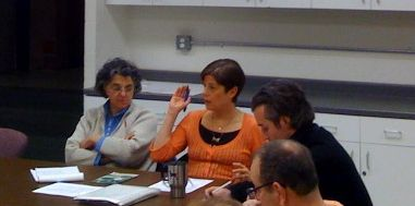 Naomi Paul (center) leads the meeting with co-chair Patricia Thiboutot (left).