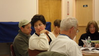 Janine Coppola (center), Director of the Mayor's Office of Constituent Services, speaks to the Clean Streets Committee