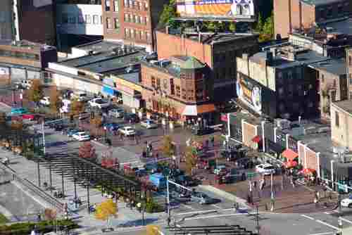 This aerial shows the Cross Street plaza with cars inside and along the curb of Cross Street. (Photo by Matt Conti. Click to enlarge.)