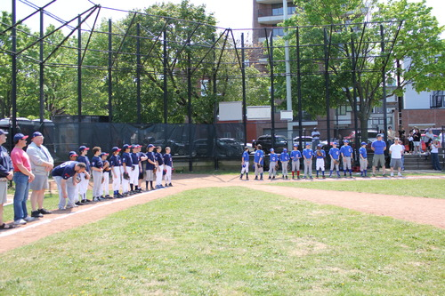 Indians and Cubs line up before the Opening Day double header at Langone Park in the North End.