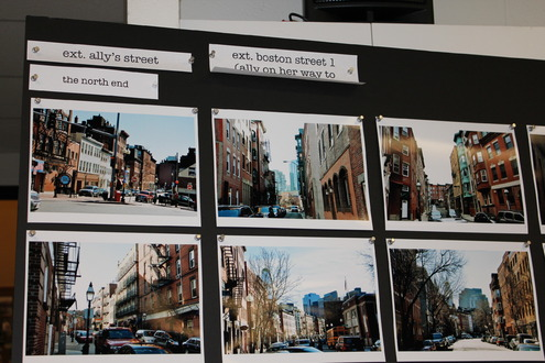 Poster boards with North End street scenes.