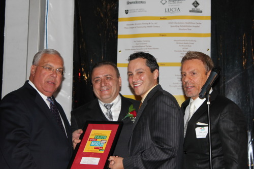 Presenting a community service award to Donato Frattaroli (2nd from left) are Mayor Tom Menino (left), Rep. Aaron Michlewitz and Jim Luisi (right), CEO of the North End Community Health Center. (Photo by Matt Conti)
