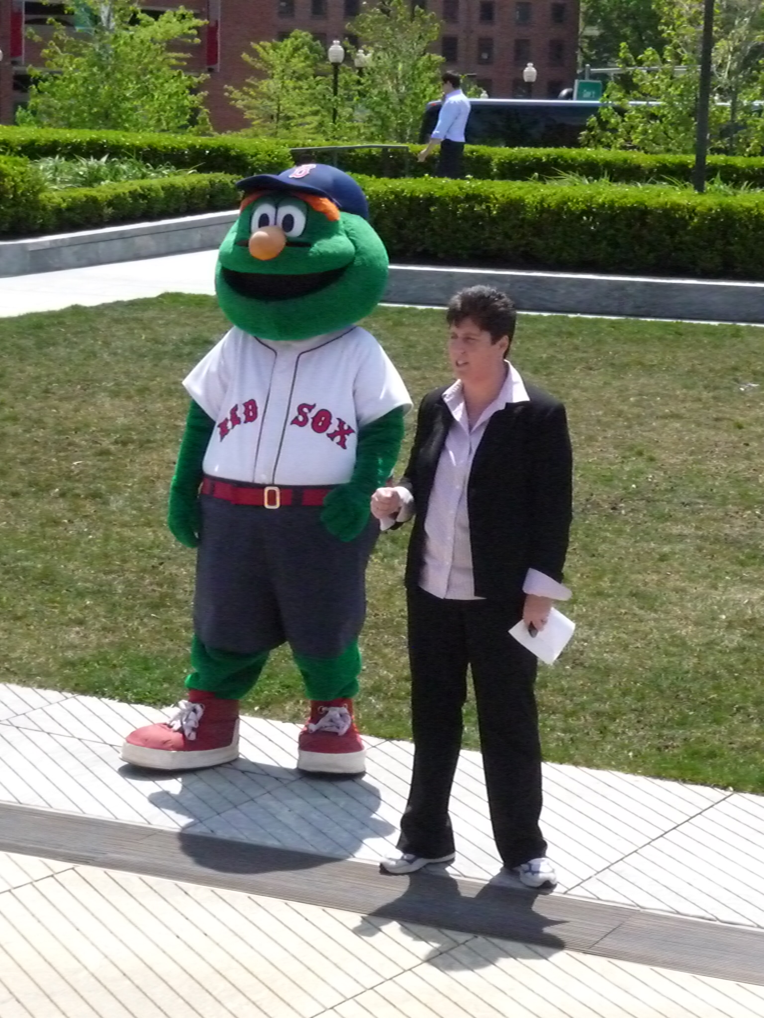 Eliot principal Traci Walker-Griffith and Boston Red Sox mascot Wally the Green Monster give students and staff a pep talk as the Eliot Walking Club gets underway