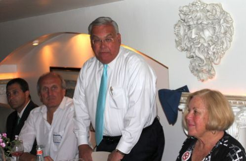 Boston Mayor Tom Menino (standing) speaks to the North End Chamber of Commerce.  From left to right sitting: Senator Anthony Petruccelli, NECC Chairman Frank DePasquale,  NECC President Joie Anzalone.