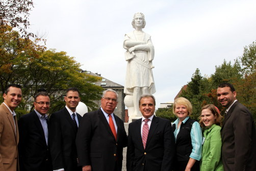 In front of the statue of Christopher Columbus, from left to right, Rep. Aaron Michlewitz, Councilor Sal LaMattina, Senator Anthony Petruccelli, Mayor Thomas Menino, Italian Acting Consul General Luigi Munno, FOCCP President Joanne Hayes-Rines, FOCCP Vice-President Trish Baumer and Councilor Felix Arroyo.