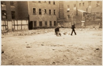 North End tenements with children playing - 1930s (Courtesy of Boston Public Library)