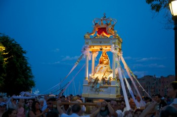 Madonna Del Soccorso bathed in blue and love at Blessing of the Fishing Waters. - August 17, 2012 - Photo by Matt Conti