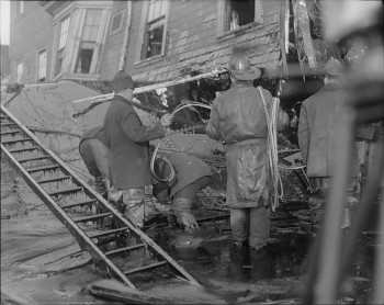 Firemen standing in thick molasses after the disaster; Leslie Jones Copyright (1886-1967 photographer) Courtesy of the Boston Public Library