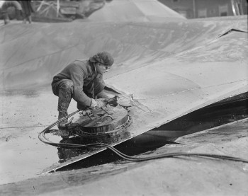 Tank cut into sections with acetylene torch in search of bodies underneath Molasses Disaster - Leslie Jones copyright - Courtesy of Boston Public Library