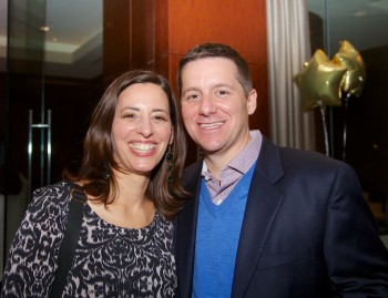 At the library fundraiser, Laura and Jason