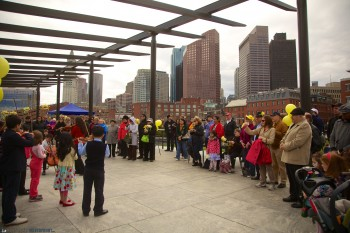 Daffodil Day Crowd Listens to the Boston String Academy under the Pergola