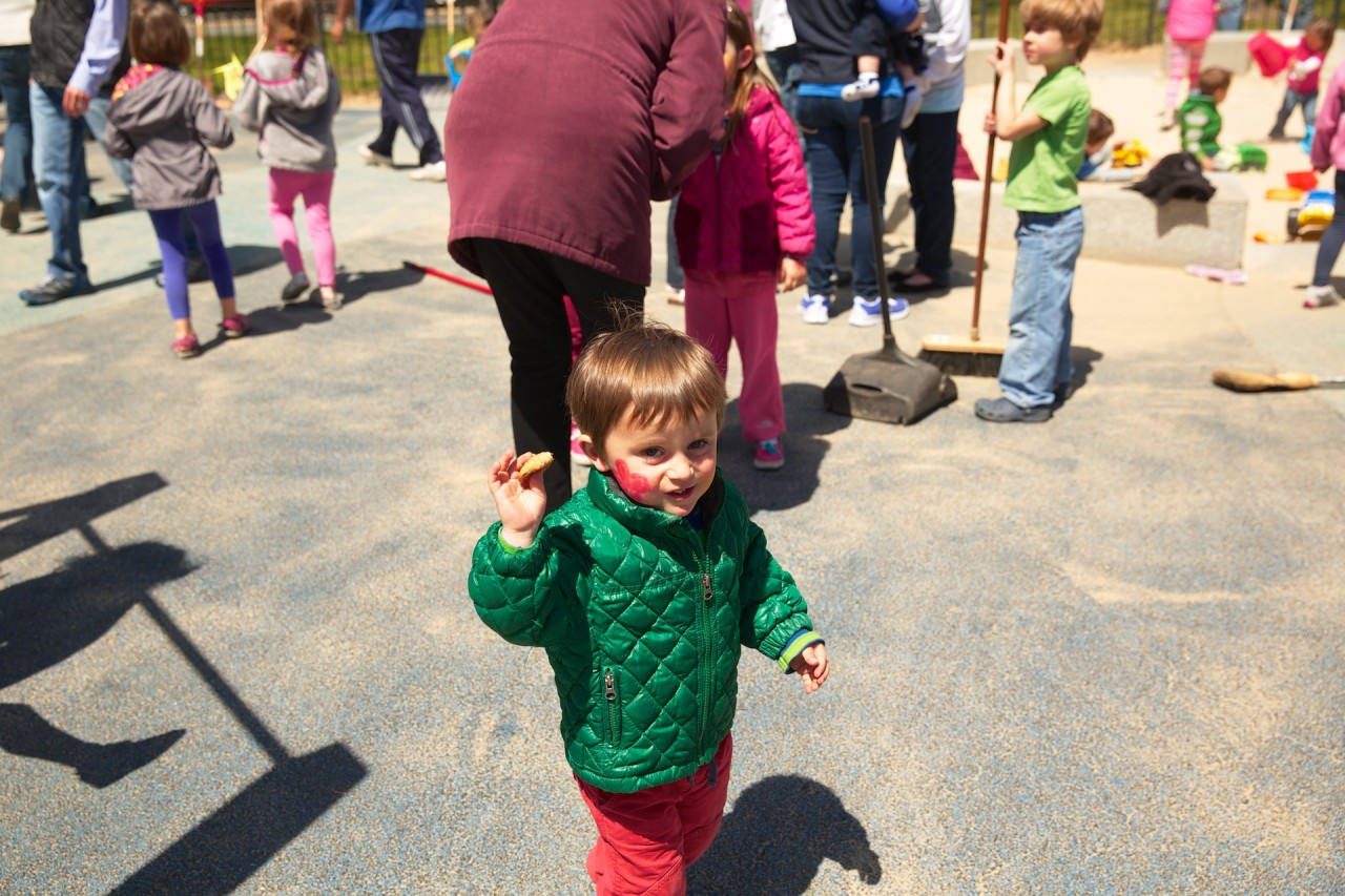 Henry enjoys the face painting, cookies and tot lot cleanup!