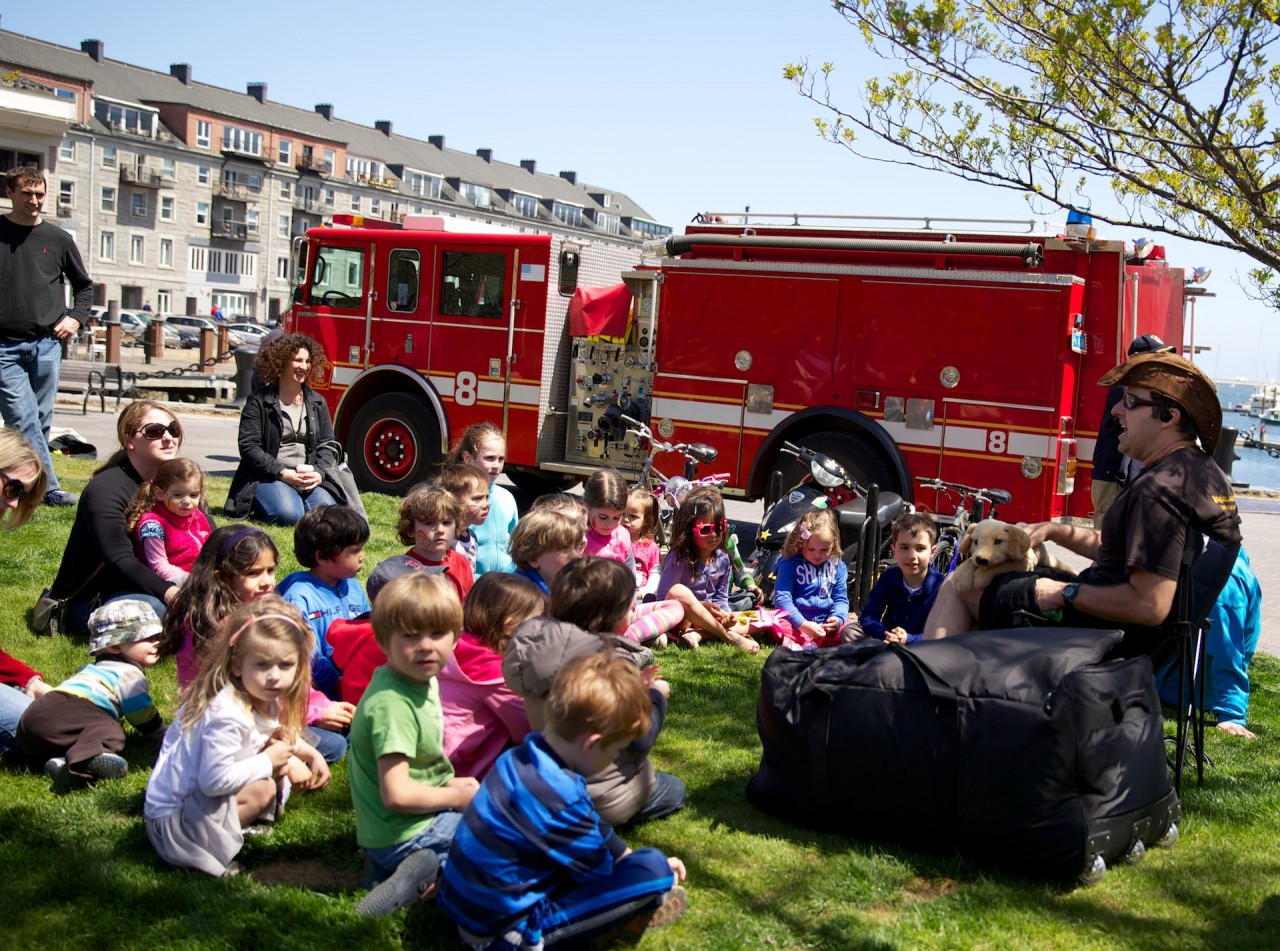 Storytelling on the lawn next to the fire truck