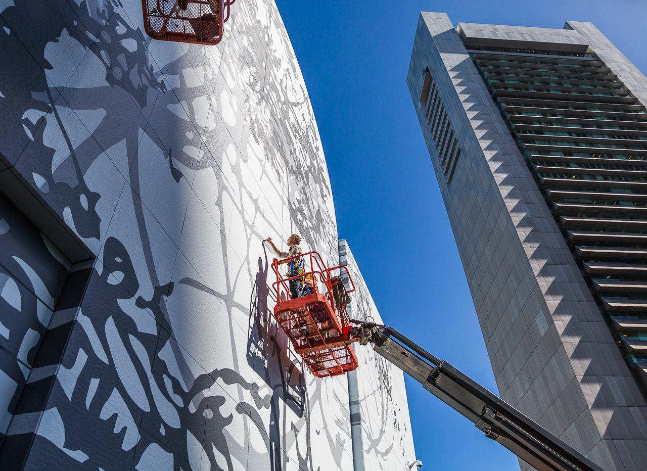 Artist Matthew Richie puts the finishing touches on the Greenway mural across from the Boston Federal Reserve Building