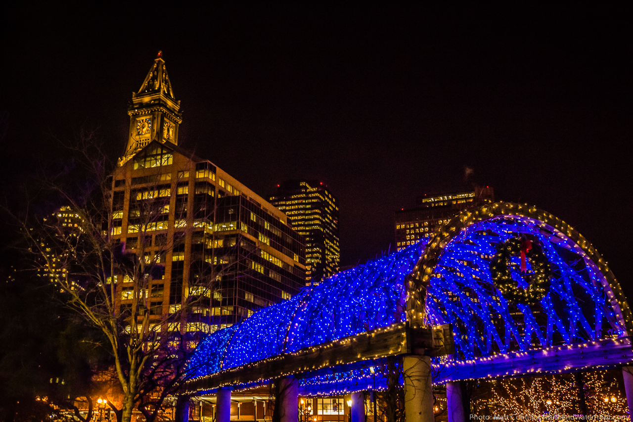 custom house towers over the blue lighted trellis lighting t