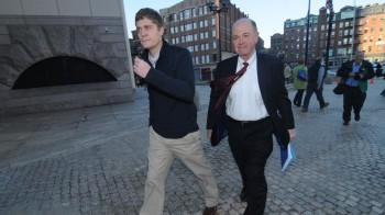 Ross Currier (L) walks with his attorney Thomas Merrigan after speaking  to media  on Wednesday, April 09, 2014 at The Edward Brooke Courthouse.  Staff photo by Patrick Whittemore.