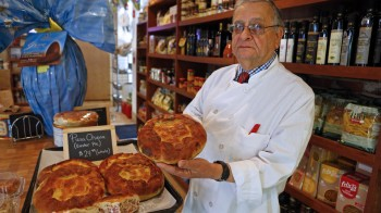 Joseph locilento, General Manager at the North End Italian butcher shop Bricco Salumeria, shows off his Pizza Chiena . Staff Photo by Nancy Lane
