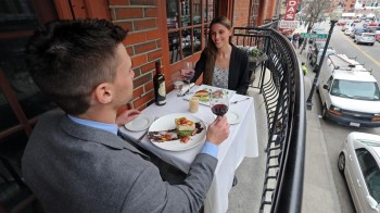 The balcony table at Tresca on Hanover Street in the North End.   Staff photo by Stuart Cahill, The Boston Herald.