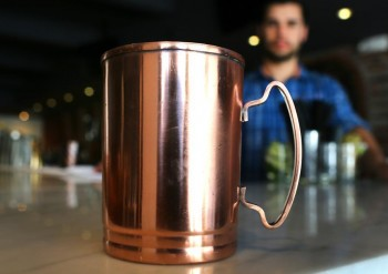 At Ward 8, a drink called the Moscow Mule is served in a copper mug that gets stolen quite a bit. JOHN TLUMACKI/GLOBE STAFF
