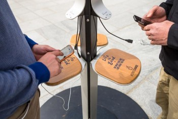 A phone charging station on the Rose Kennedy Greenway. Credit: Aram Boghosian for Boston.com