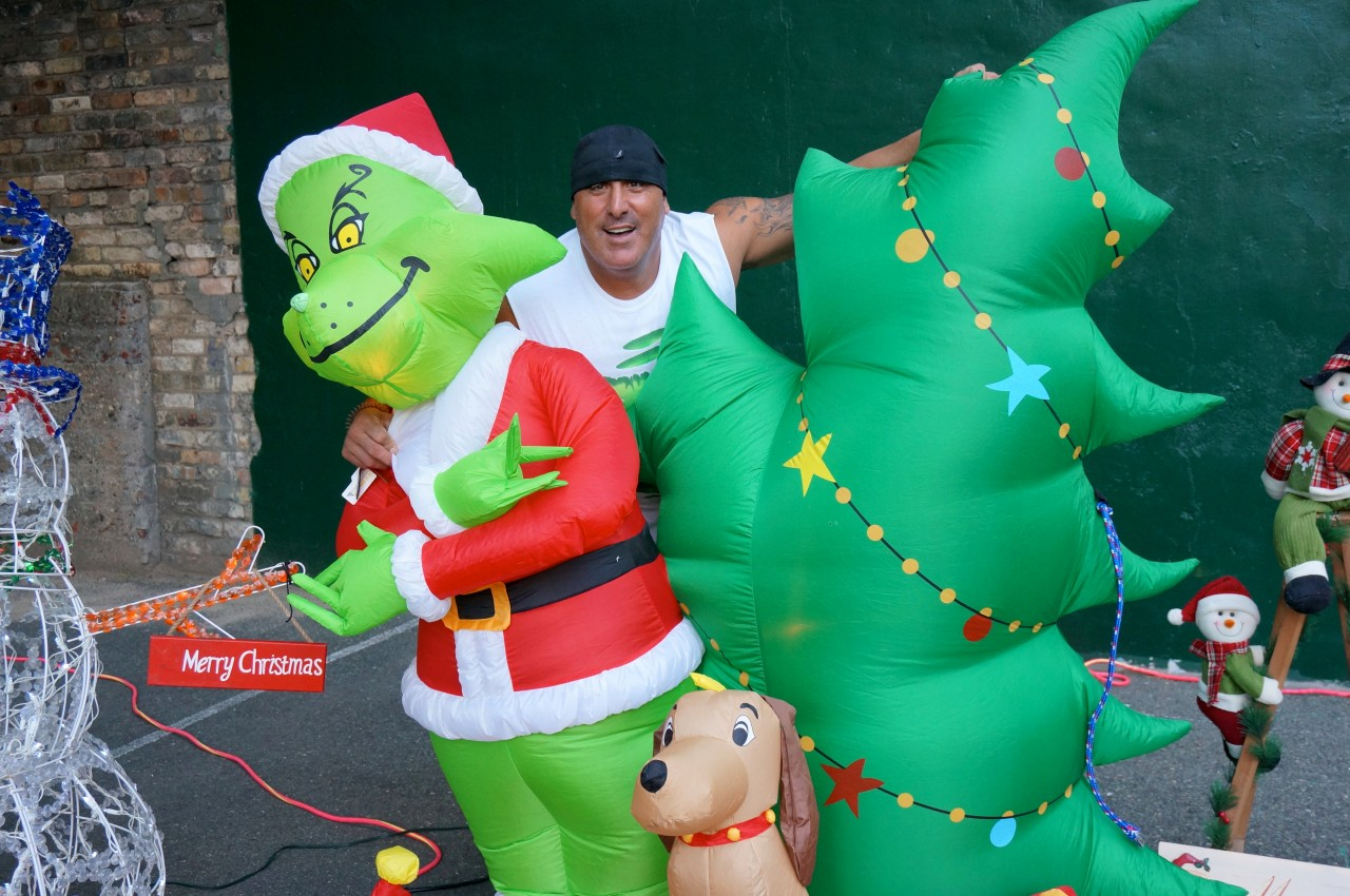 Volunteer and event organizer Steven Virgilio poses for a picture with a few Christmas decorations.
