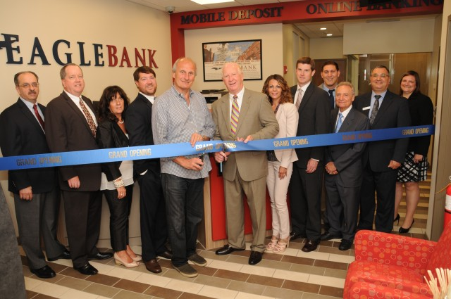 Pictured from left to right:  Vincent Panzini, North End Chamber member and Eagle Bank Corporator, James Barrett, EVP / CFO, Maria Safina, North End Branch Sales and Service Associate, Marc Whittaker, EVP / Retail Administration & General Counsel, Frank DePasquale, Chairman of the North End Chamber of Commerce and owner of DePaquale Ventures, James H. Whittaker, President & CEO, Gisella DiPaola, AVP / Business Development Officer & North End Branch Manager, Derek Delaney, EVP / Commercial Loan Officer, Fernando Giangregorio, owner of Green Cross Pharmacy, Christian Guarino, North End Branch Sales & Service Manager, Joseph Galvao, North End Branch Sales & Service Manager, and Heather Wetterneck, VP / Retail Administrator. (Photo by Rosario Scabin, Ross Photography)