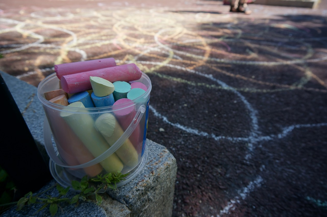 Sidewalk chalk, just one of the many interactive activities for all ages!