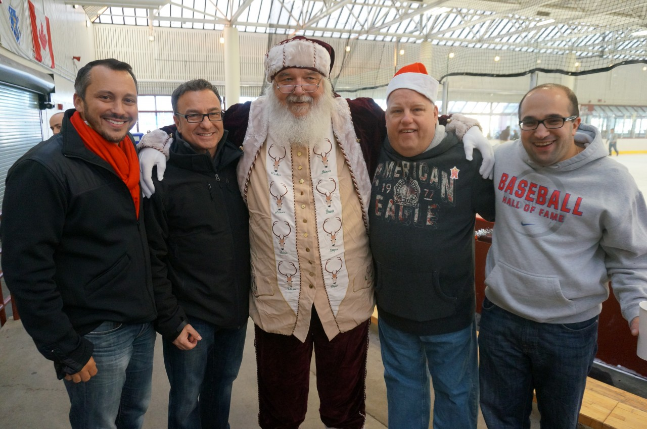 State Rep. Aaron Michlewitz, City Councilor Sal LaMattina, Michael Magner and Matt Bamonte pose for a photo with Santa!