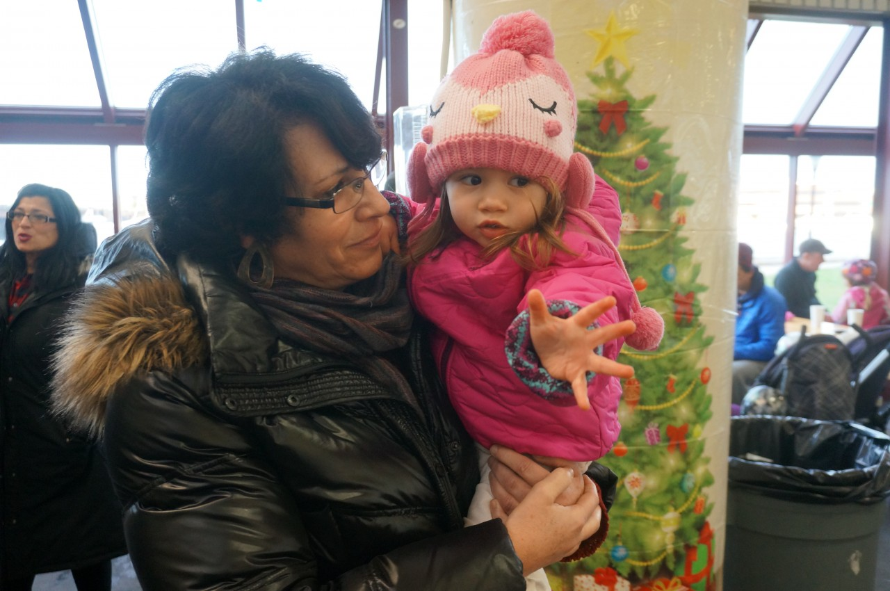 Sheila Moretti with her granddaiughter Guilia as she reaches for Santa