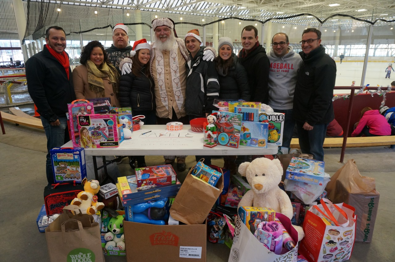 Toys filled the front table along with volunteers