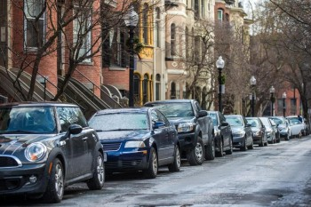 ARAM BOGHOSIAN FOR THE BOSTON GLOBE The city currently offers residents a free parking pass for every vehicle they own, despite a limited number of spots. Pictured: Cars parked on Rutland Square in Boston.