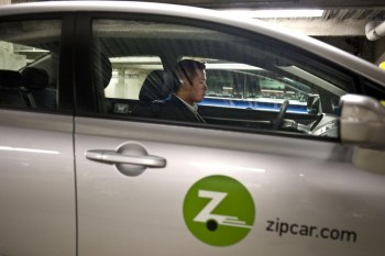 How do you feel about car-sharing services taking public parking spaces? Photo by Wiqan Ang, The Boston Globe.