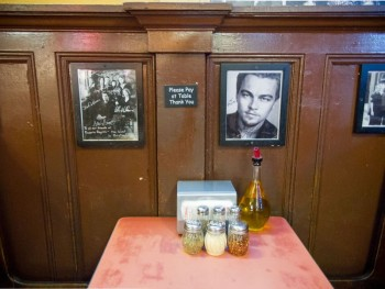 A booth in the famous Pizzeria Regina, photo by Katie Chudy for Eater