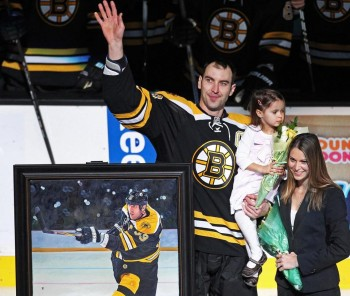 Chara with his wife, Tatiana, and their daughter Elliz Victoria. Photo by Jim Davis, The Boston Globe.
