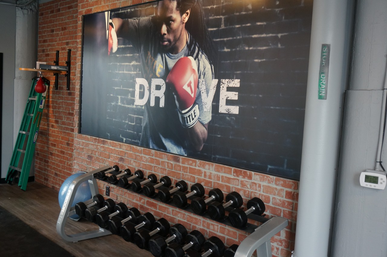 In addition to heavy bags, the club has weights and cardio machines.