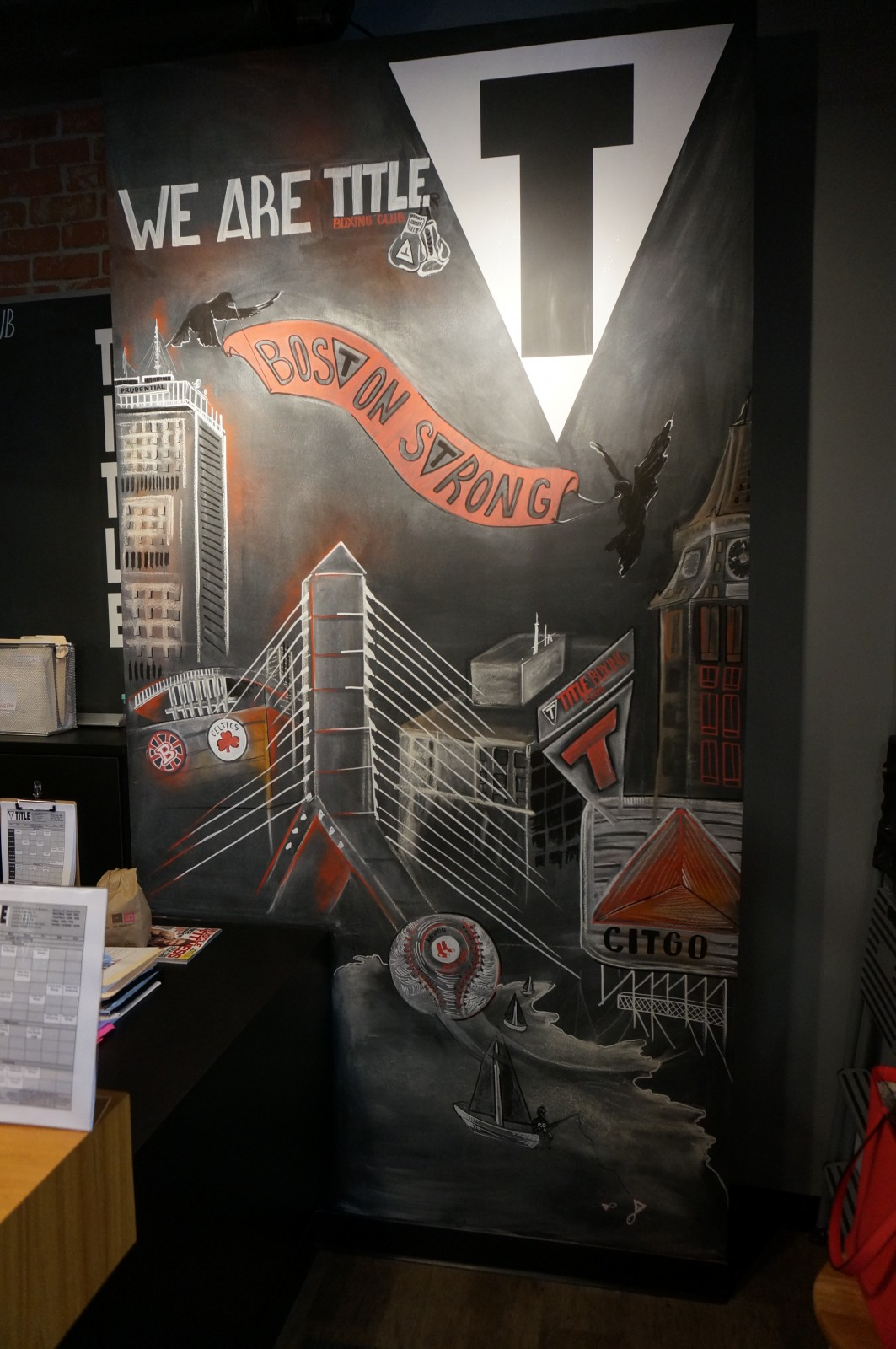 """""""Being part of the community is important to me"""" says Owner Mike Musto, as he looks at his hand drawn mural incorporating Boston and Title Boxing."""