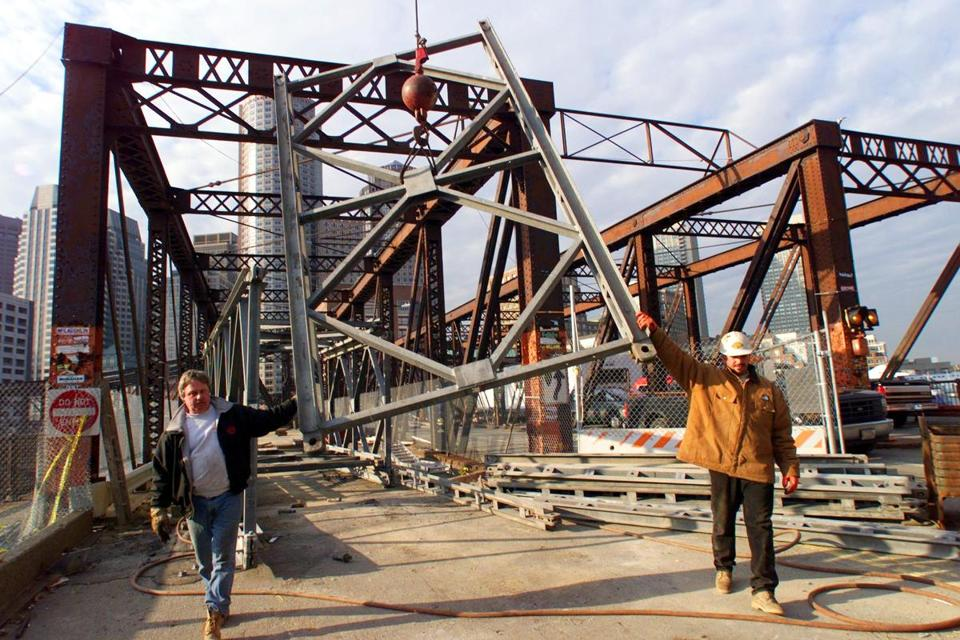 Workers removed a section of a steel pedestrian walkway that spanned the old Northern Avenue Bridge in 1999. Photo by John Tlumacki, The Boston Globe.