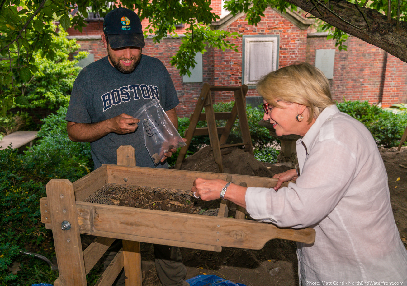 Archaeologist Joe Bagley supervises Susan at the sifter