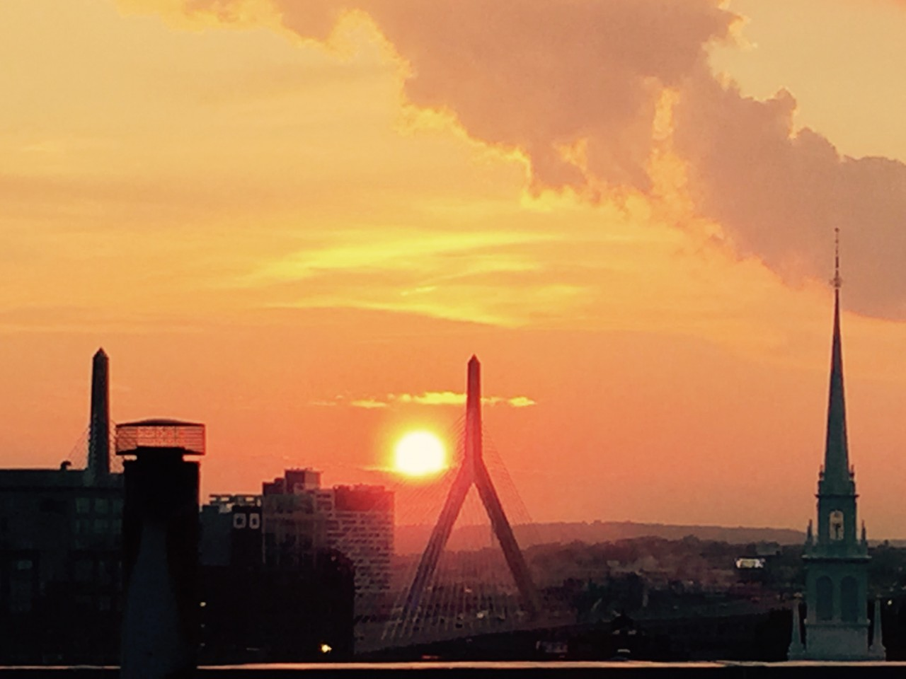 This Flashback Friday takes us back to exactly one year ago, where Rita Pagliuca captured this golden summer sunset over the North End looking toward the Zakim Bridge.