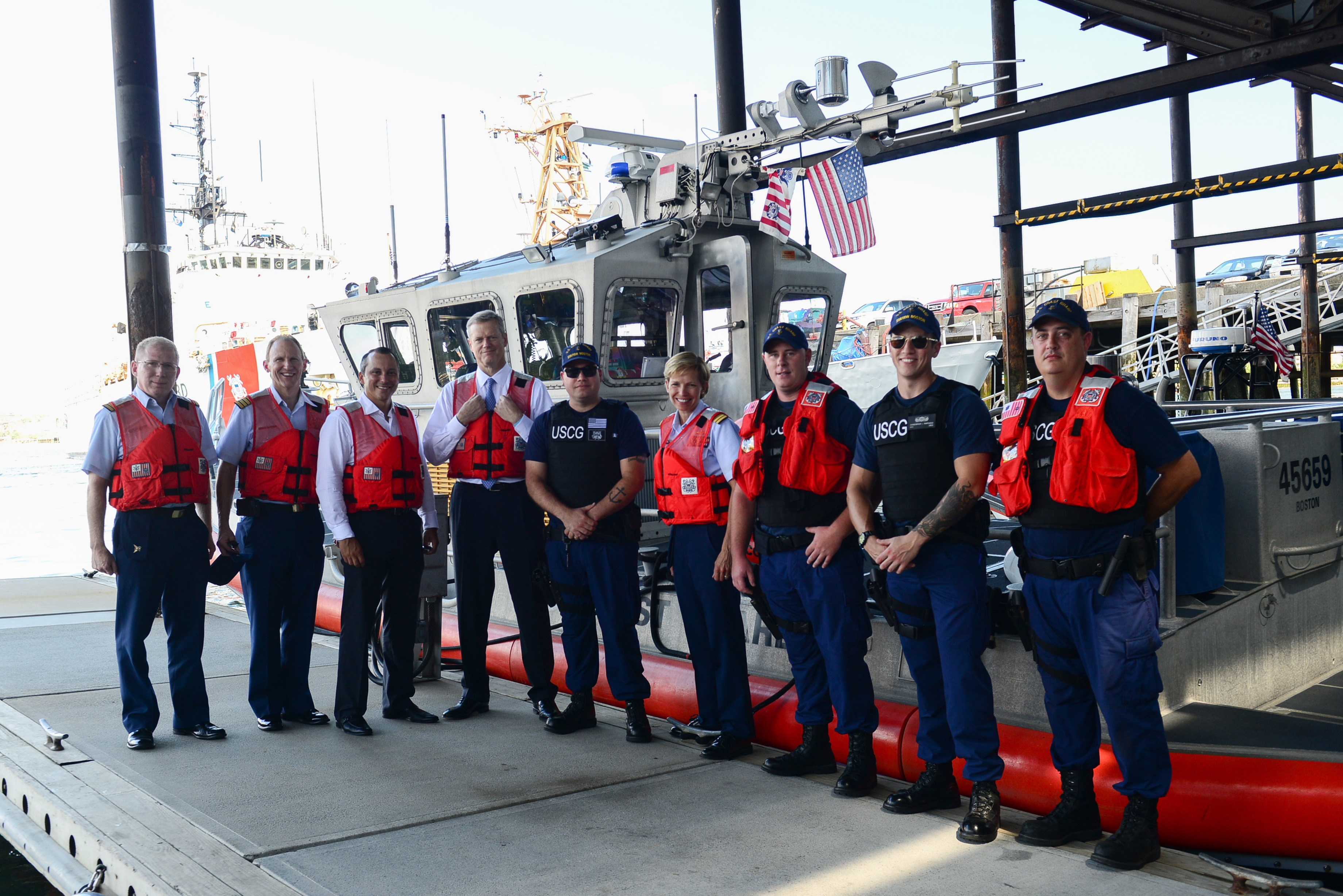 Massachusetts Gov. Charlie Baker and State Representative Aaron Michlewitz before getting underway in Boston Harbor with Coast Guard Station Boston Monday, Aug. 15, 2016. Baker and Michlewitz toured the Sector Boston's command center, met with Capt. Claudia Gelzer, Captain of the Port of Boston and commander of Sector Boston, and got underway with a Station Boston 45-foot response boat crew to observe the key recourses and critical infrastructures in and around Boston Harbor protected by Boston-based Coast Guard units. U.S. Coast Guard photo by Petty Officer 2nd Class Cynthia Oldham