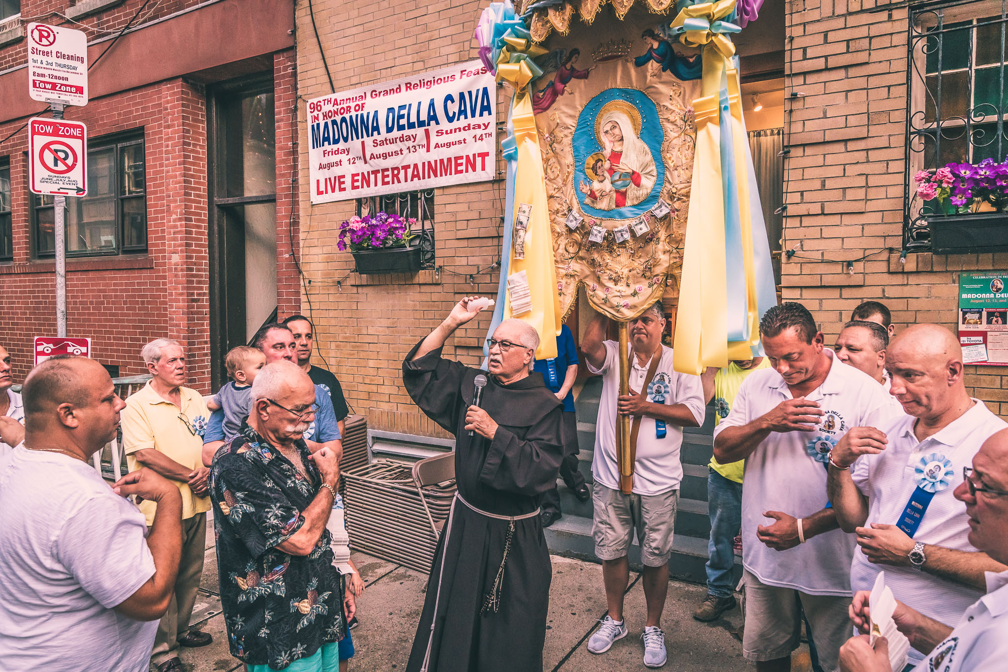 Father Claude blesses the Madonna Della Cava Feast