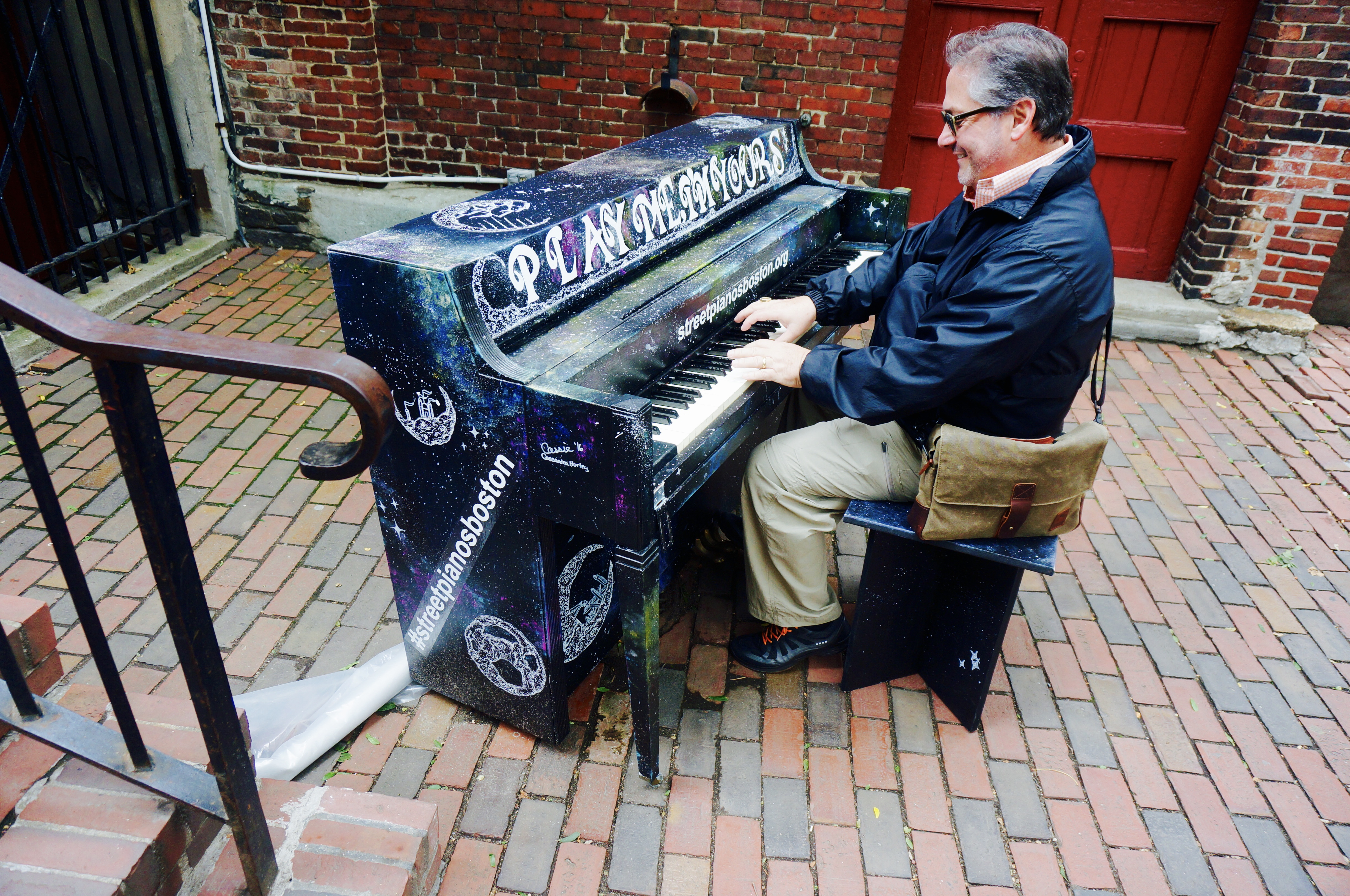 Sam from New Orleans plays a jazzy riff on the Piano behind Old North Church.