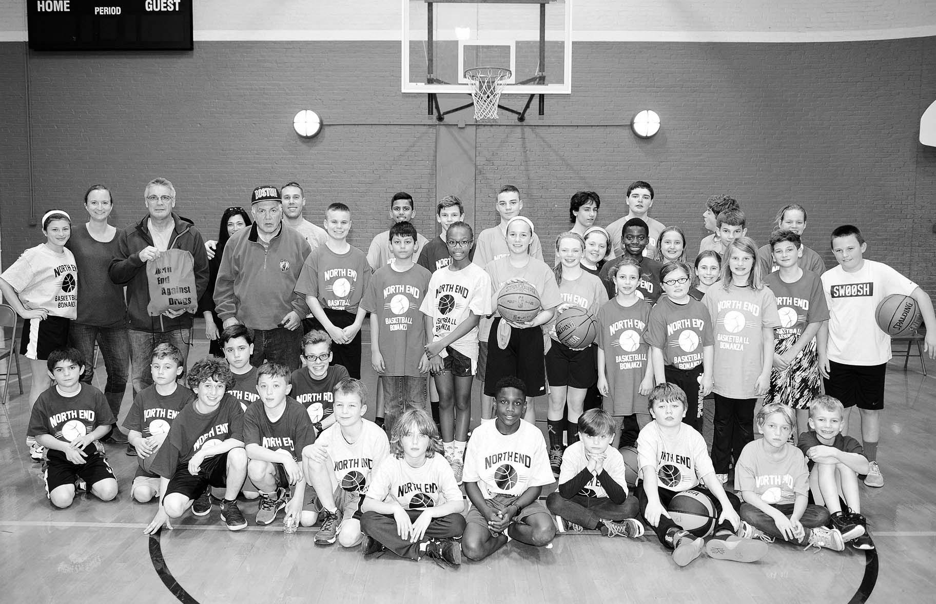 Children, organizers and coaching staff stood together in the Nazzaro Center before the start of the basketball clinic.