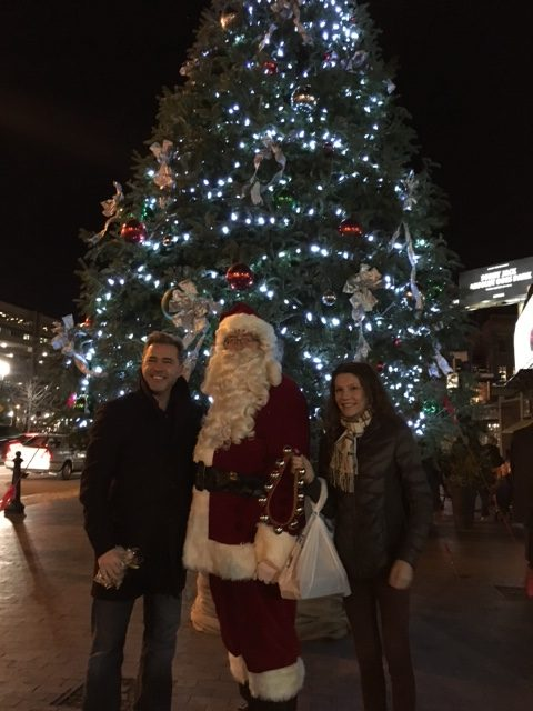 Eamon O'Marah sponsored this year's tree, shown here with his daughter, Margot, and Santa Claus