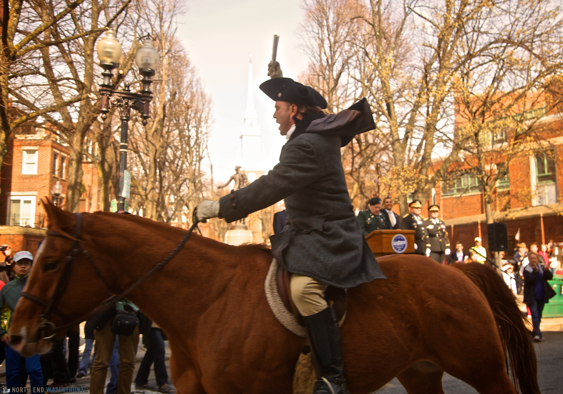 re enacting paul revere s midnight ride on hanover st in front of