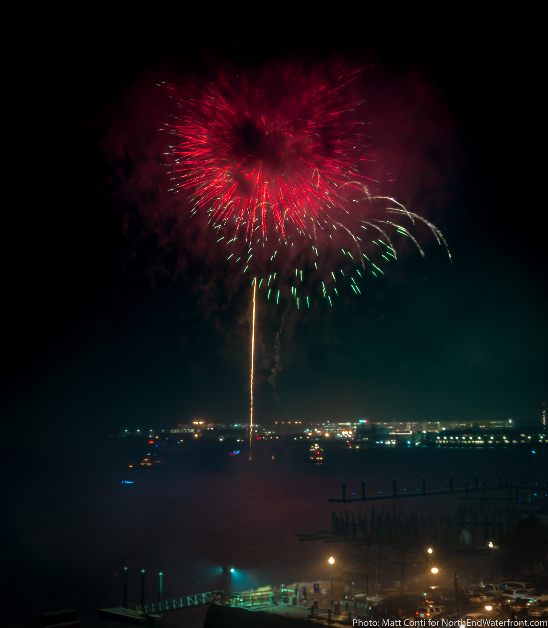 Midnight Fireworks on Boston Harbor Ring in a Soggy Start to